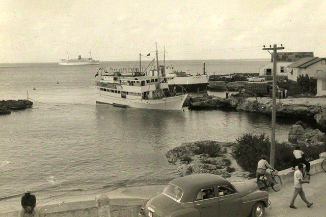 M.V. 'Merco' and M.V. 'Judy' docked in George Town Harbour, with S.S. Evangeline (Cruise Ship) anchored behind. Photo by: Leslie E. Hines